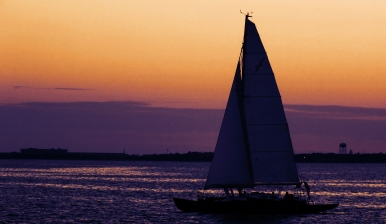 Sunset And Sailboat
